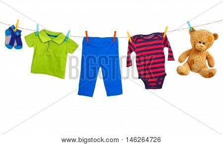 Laundry line with colorful clothes on a white background