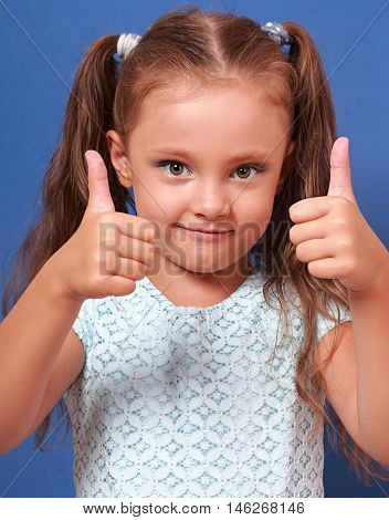 Happy Smiling Kid Girl Showing Two Hands Thumb Up On Blue Background