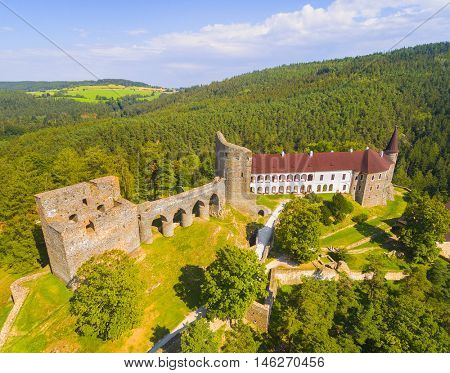 Gothic castle Velhartice in National Park Sumava. Aerial view to medieval monument in Czech Republic. European landmarks from above.