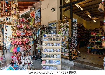 SPILI, CRETE, GREECE - JULY 2016: Street shop with traditional Greek souveniers on Crete island.