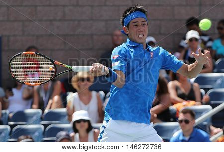 NEW YORK - AUGUST 30, 2016: Professional tennis player Kei Nishikori of Japan in action during his first round match at US Open 2016 at Billie Jean King National Tennis Center in New York