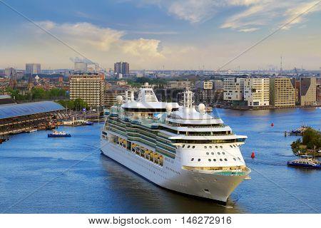 Amsterdam, Netherlands - MAY 13, 2016: Royal Caribbean cruise ship Serenade of the Seas heading to cruise terminal.