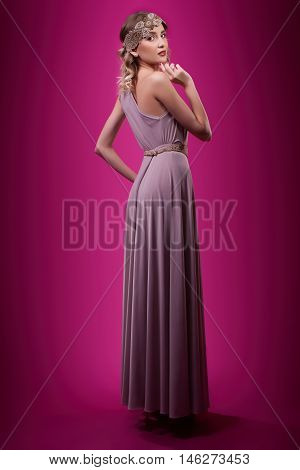 young fashion beautiful woman on pink background