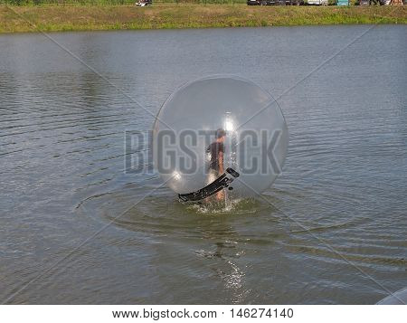Interesting entertainment for children swimmings in water of a nutria of the balloon