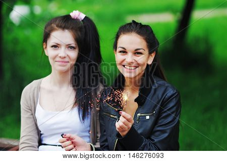 Portrait Of A Happy Young Women With Long Dark Hair. Two Beautiful Girlfriend Was Found In The Summe