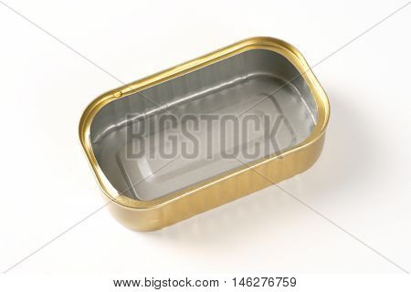empty tin of sardines on white background
