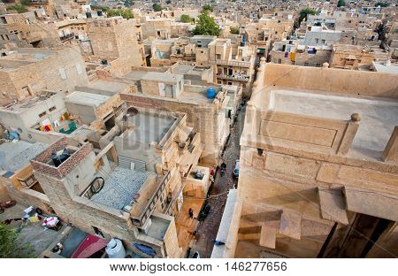 JAISALMER, INDIA - MAR 1, 2015: High point view on the streets of poor area in historical indian town on March 1, 2015. Jaisalmer lies in the heart of the Thar Desert and has a population of about 78000.