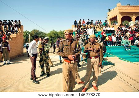 JAISALMER, INDIA - MAR 1, 2015: Policemen keep order on the popular indian events of Desert Festival on March 1, 2015 in Rajasthan. Every winter Jaisalmer takes the Desert Festival