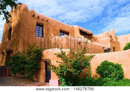 Southwestern adobe style building with Spanish colonial architectural design taken in Santa Fe, NM