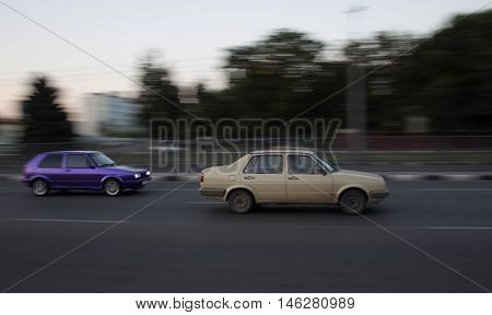 the movement in the pictures looks beautiful and interesting vehicles in trafficthe rotation of the wheels blur around