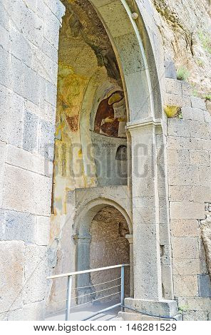 VARDZIA GEORGIA - MAY 27 2016: The view through the stone arch on the murals of Dormition Church in cave on May 27 in Vardzia.
