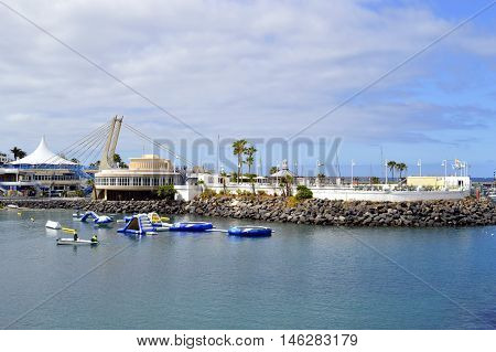 Torviscas harbour Tenerife Canary Islands Spain Europe - June 15 2016: Tourism in Torviscas a coastal town of Tenerife