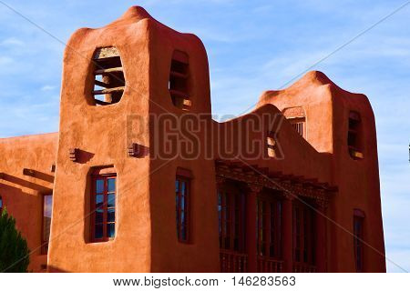 Adobe building with a combination of historic and modern architecture and design taken in Santa Fe, NM