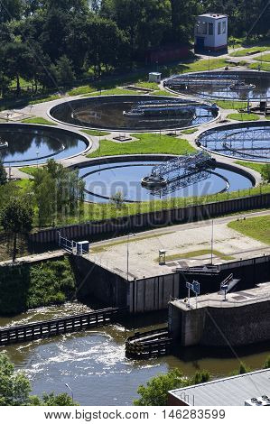 Sewage Water Treatment Plant With River In Foreground Aerial View