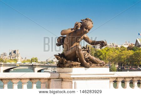 The sculpture of Alexandre III bridge.The bridge is widely regarded as the most ornate extravagant in Paris and classified as Historical monument.
