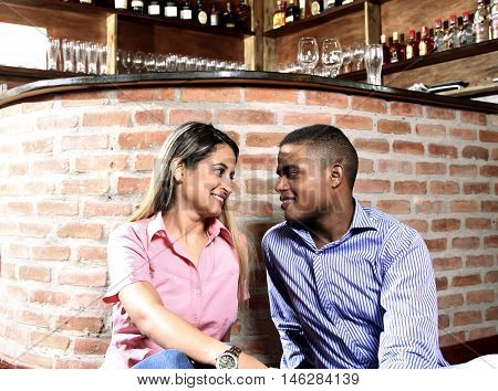 young couple in love talking in a restaurant