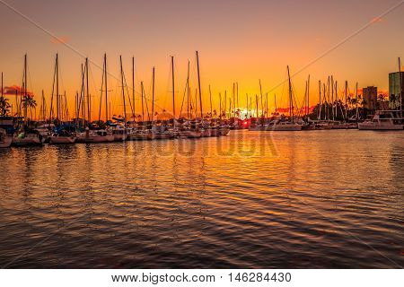 Beautiful view of Ala Wai Harbor at sunset. Ala Wai Harbor is the largest small-boat and yacht harbor in Hawaii, situated between Waikiki and Honolulu downtown