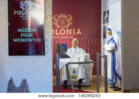 KRAKOW, POLAND - FEB 8, 2016: Entrance to Polonia Wax Museum at Main Market Square. Wax Museum is among the top 10 museums in the city.