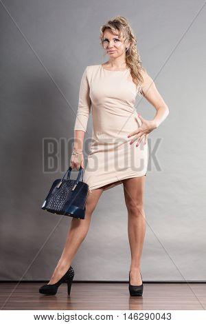 Woman With High Heels And Handbag.