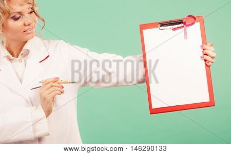 Doctor Showing Folder With Pink Ribbon By Pen.
