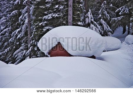 Snow Covered Wooden Cabin