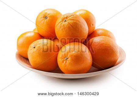 oranges on wooden platter close-up isolated on white background