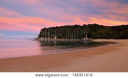 Sunset on a Sandy Tropical Beach.  Te Pukatea Bay, Abel Tasman National Park, New Zealand