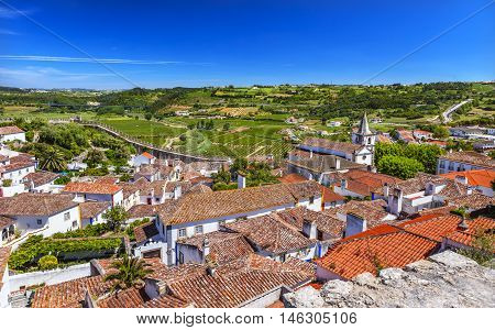 Castle Wals Countryside Farmland Medieval Town Santa Marica Church Obidos Portugal. Castle and walls built in 11th century after town taken from the Moors.