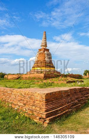 Old buddha pagoda temple with cloudy sky in Ayuthaya Thailand