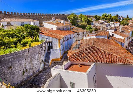 Castle Wals Narrow Street Medieval Town Obidos Portugal. Castle and walls built in 11th century after town taken from the Moors.