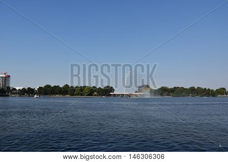 HAMBURG, GERMANY - AUG 26: Fountain at Alster Lake in Hamburg, Germany, as seen on Aug 26, 2016. In the city center, the Alster river forms two lakes, both prominent features in Hamburg's cityscape.