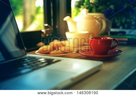 Coffee Cup, Tea Pot ,cookies And Laptop