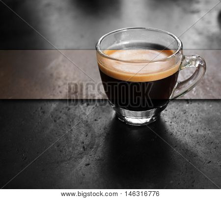 Cup of hot fresh espresso coffee, color and monotone