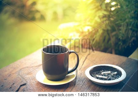 Cup Of Hot Coffee On Woden Table And Ashtray