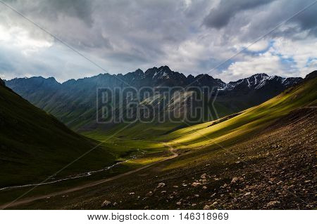 Sun rays in Tien-Shan mountains in Kyrgyzstan