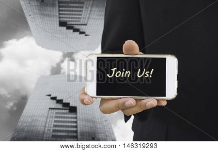 abstract background business man show message on smartphone said join us on blur double bilding and sky background - can use to display or montage product or show feeling blue