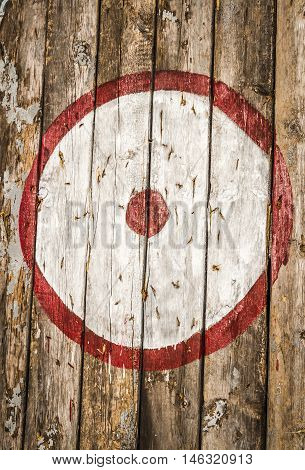 Target archery on old wooden boards close up.