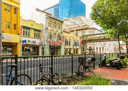 SINGAPORE, REPUBLIC OF SINGAPORE - JANUARY 09, 2014: Street view of Singapore city. Road traffic and old colonial buildings