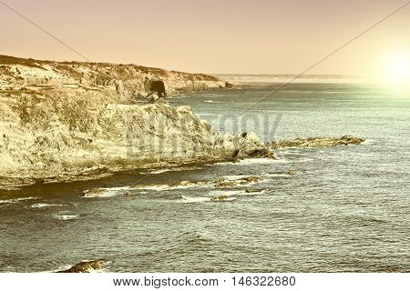 Rocky Coast of Atlantic Ocean in Portugal at Sunset Vintage Style Toned Picture