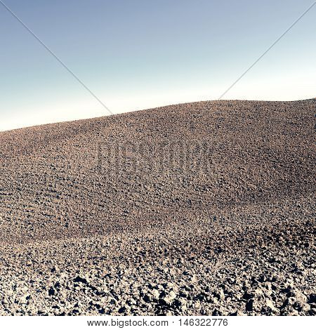 Plowed Sloping Hills of Tuscany in the Autumn Vintage Style Toned Picture