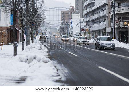 Sapporo Hokkaido JAPAN - December 12 2011: Traffic on the street in downtown of Sapporo in winter Hokkaido Japan