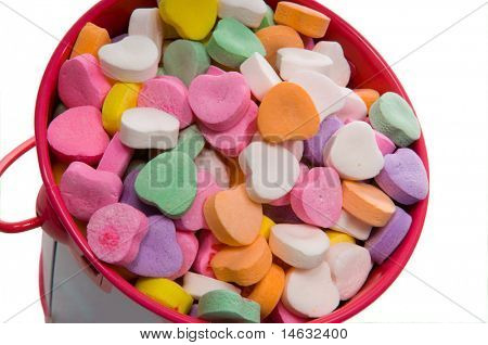 Bucket full of candy hearts in assorted colors for Valentine's Day