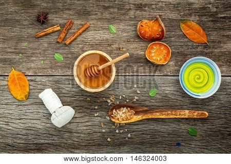 Composition Of Nature Spa Ingredients On The Dark Wooden Table. Spa And Wellness With Dried Indian B