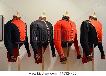 Moscow, Russia - August 30, 2016 - Russian officers uniforms 19th century, handmade. Exhibition of casual and evening gowns in The State A.S.Pushkin Museum.