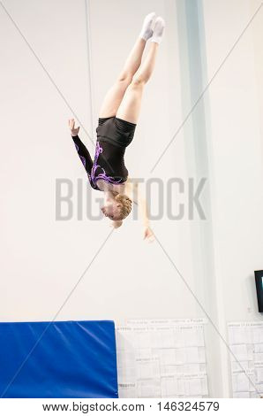 Orenburg, Russia - 19 April 2016: Girls compete in jumping on the trampoline on Championship privolzhskiy district.