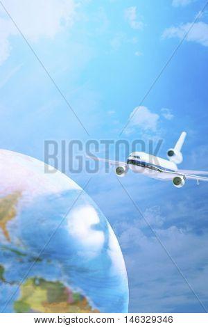 Aeroplane toy next to globe studio shot