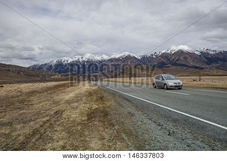 ARTHUR'S PASS NEW ZEALAND-SEPTEMBER 2 : suv traveling car on highway in Arthur's Pass national park important traveling destination in south island on september 2 2015 in new zealand
