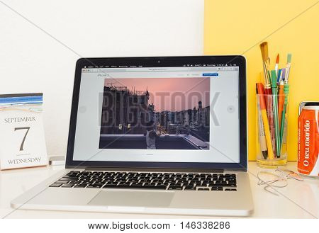 PARIS FRANCE - SEP 8 2016: Apple Computers website on MacBook Pro Retina in a geek creative room environment showcasing a photo taken with iPhone 7