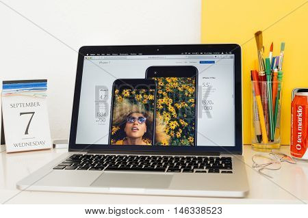 PARIS FRANCE - SEP 8 2016: Apple Computers website on MacBook Pro Retina in a geek creative room environment showcasing differences between iphone 7 and iphone 7 plus