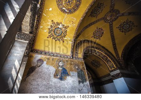 ISTANBUL TURKEY - APRIL 15 2015 : Jesus Christ old Mosaic which is known as Christ Pantocrator. He is by the Virgin Mary and John Baptist inside the Hagia Sophia cathedral Istanbul